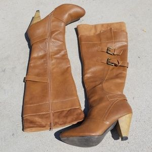 Knee high leather and suede boots